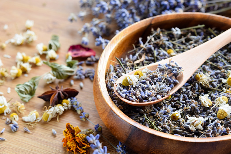 Dried lavender in a wooden bowl.