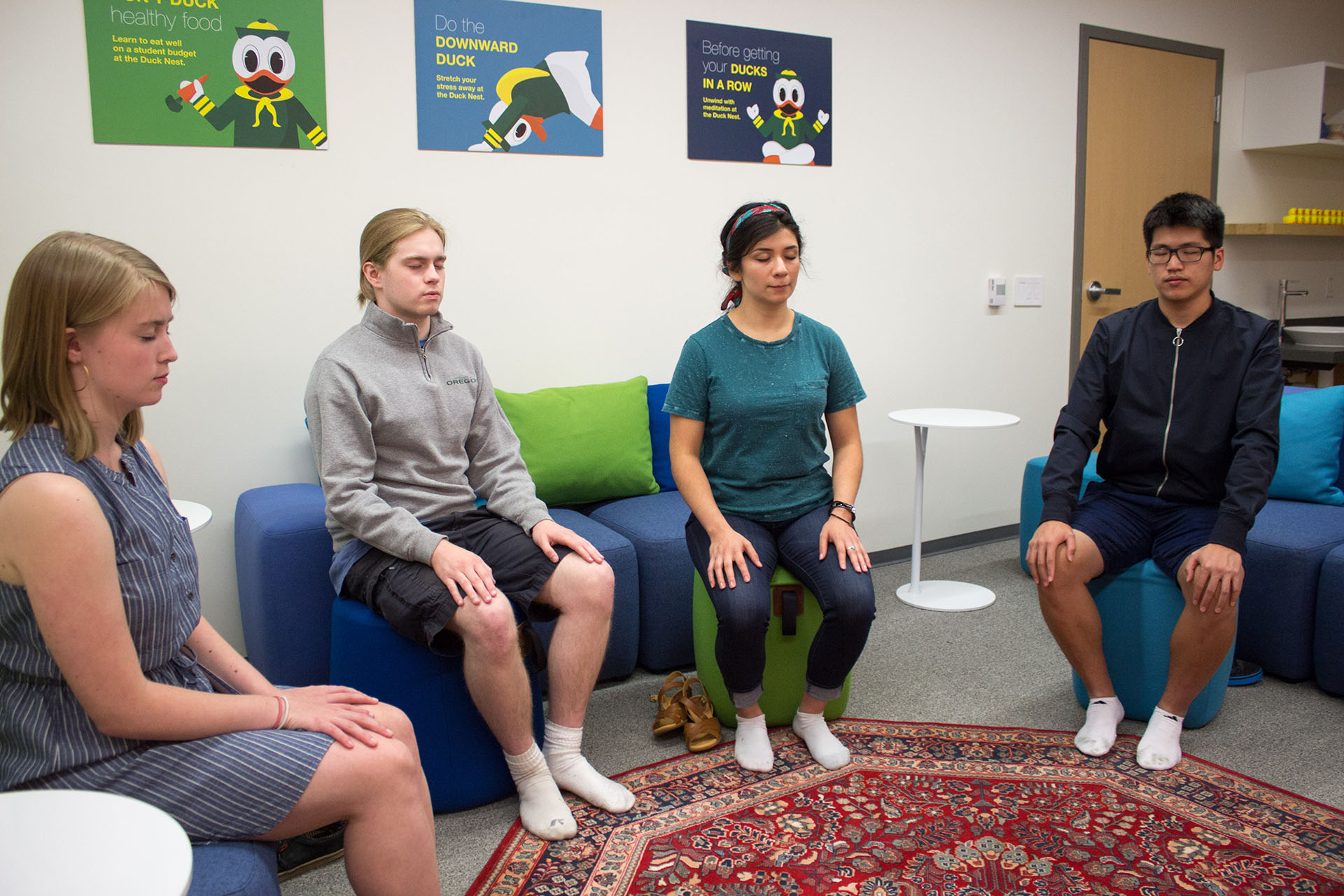 Students participate in a relaxation meditation in the Duck Nest.