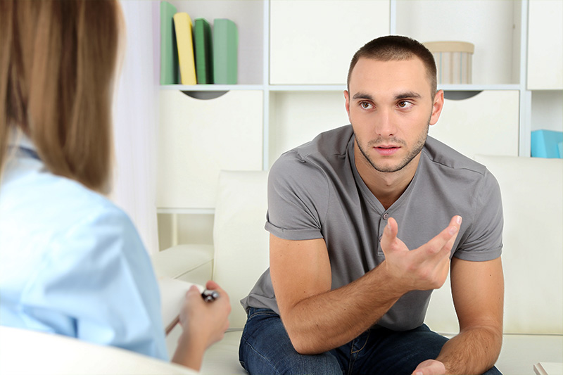 A student talking to a psychiatrist.